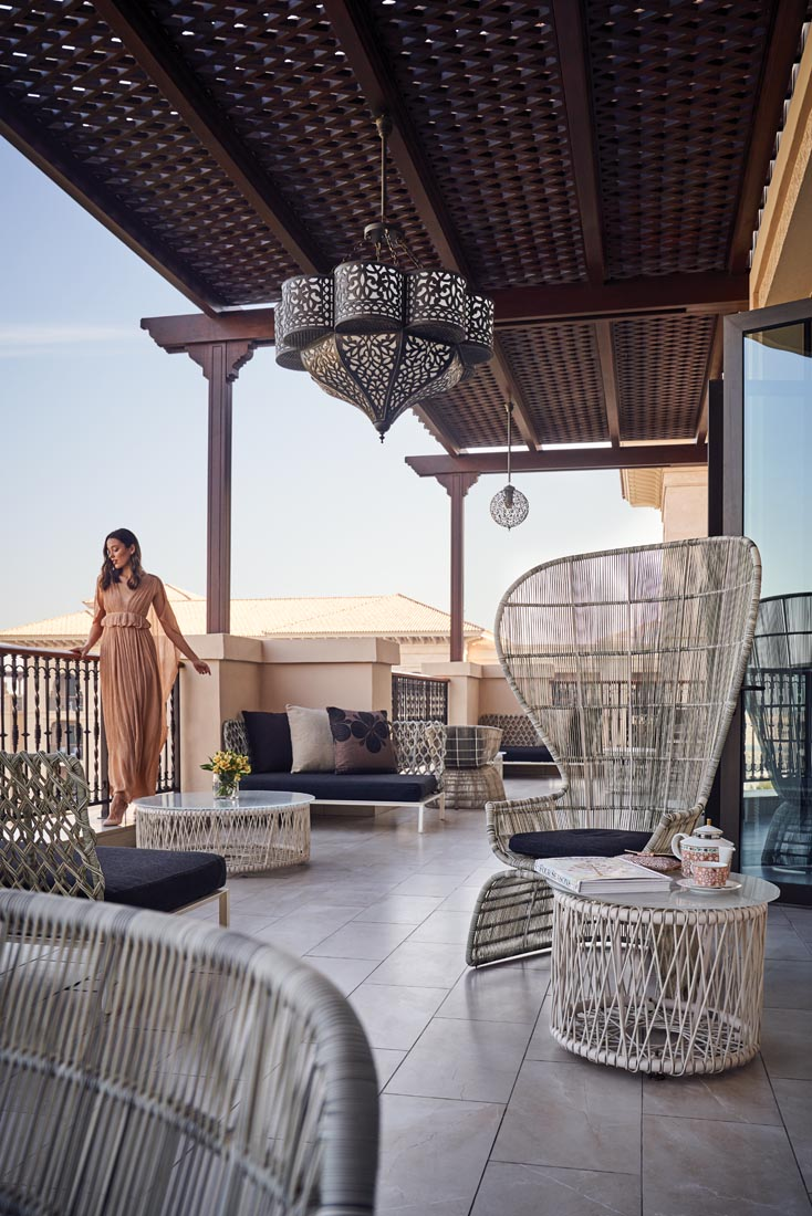 A full-width elegantly furnished terrace bestows glorious beach unbroken and endless ocean views Gown, Chloé Heels, René Caovilla Bag, Stuart Weitzman