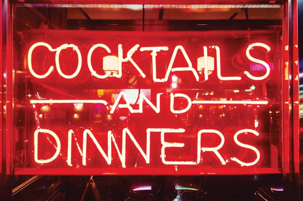 Cocktails And Dinners red illuminated neon sign