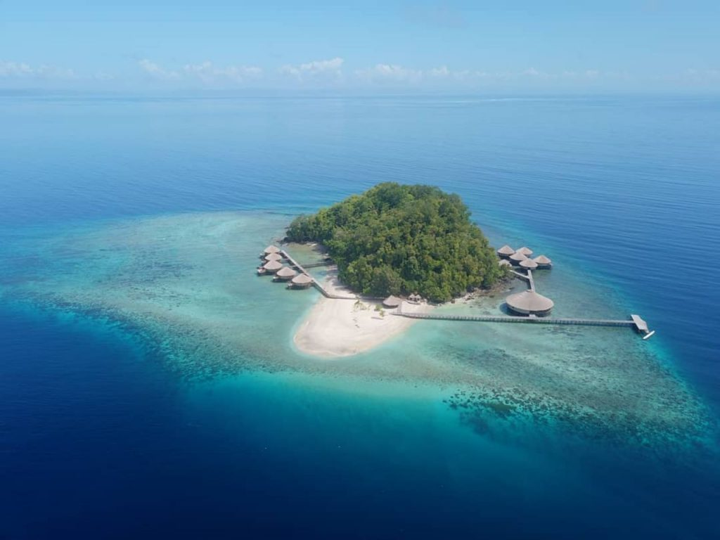 Aerial shot of the MajaRaja Eco Dive Lodge in the middle of the ocean
