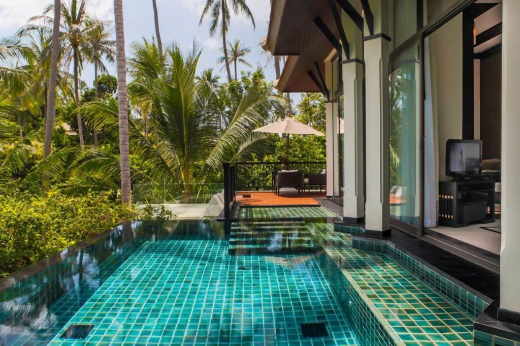 Pool balcony surrounded by palm trees in Banyan Tree Samui