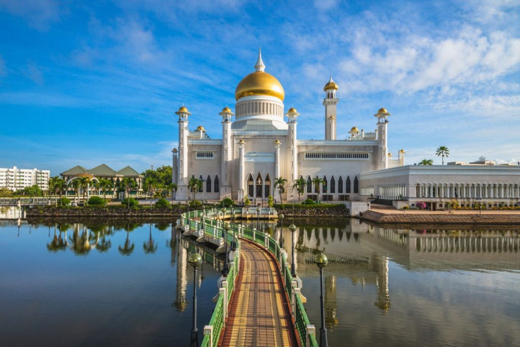 The pathway into Sultan Omar Ali Saifuddien Mosque on a sunny day in Brunei